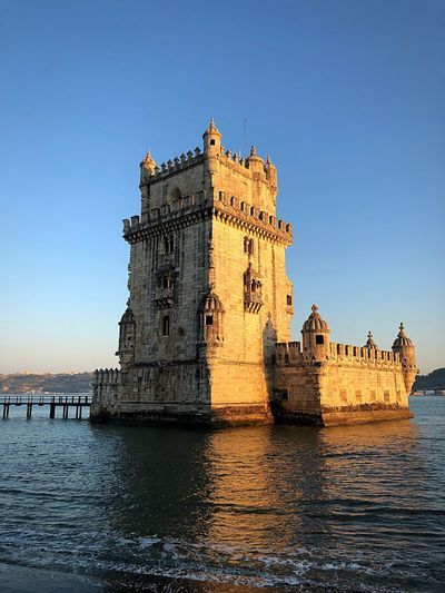 Torre de Belem EyeEm Selects Water Sky Architecture Built Structure Clear Sky Waterfront History Building Sea Travel Destinations Travel Blue Day