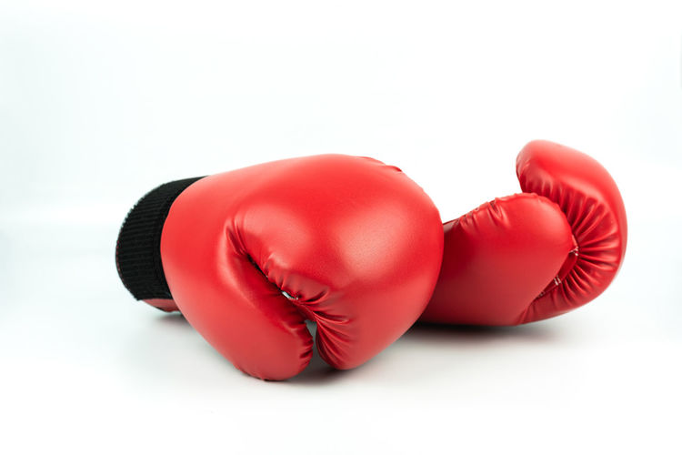 Close-Up Of Red Boxing Gloves Over White Background
