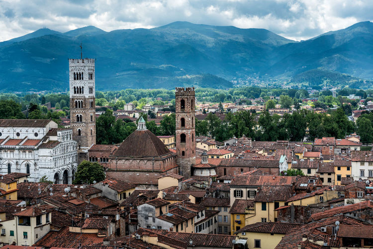 View over Italian town Lucca with typical terracotta roofs Lucca Mediterranean  Tuscany View Architecture Building Exterior Day Italian Landmark Medieval Mountain Outdoors Sky Terracotta Town