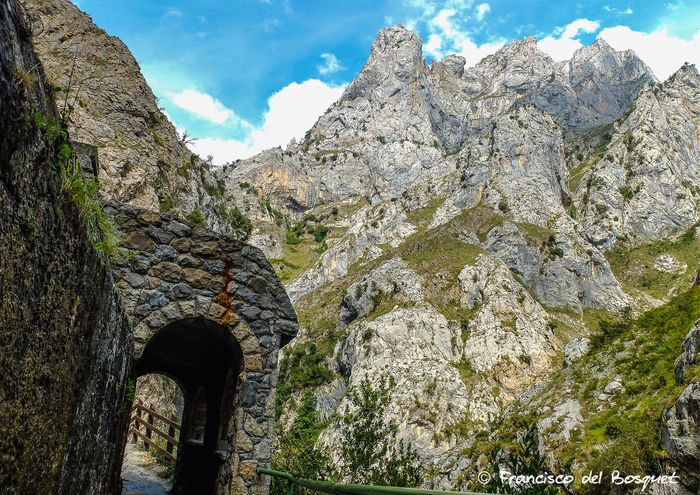 Arch Beauty In Nature Blue Cloud Cloud - Sky Day Landscape Low Angle View Mountain Mountain Range Nature Outdoors Picos De Europa Rock - Object Rock Formation Rock Formation Rocky Mountains Rutadelcares Scenics Sky Sunlight Tranquil Scene Tranquility Tree