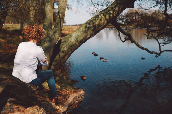 Beauty In Nature Blonde Blue Jeans Casual Clothing Curly Hair Day Girl Original Experiences Lakeshore Leisure Activity Lifestyles London Nature Outdoors Pond Richmond Park, London Scenics Spring Tranquil Scene Tranquility Tree Tree Trunk Vacations Water White Shirt EyeEm LOST IN London Breathing Space Been There. Lost In The Landscape Postcode Postcards