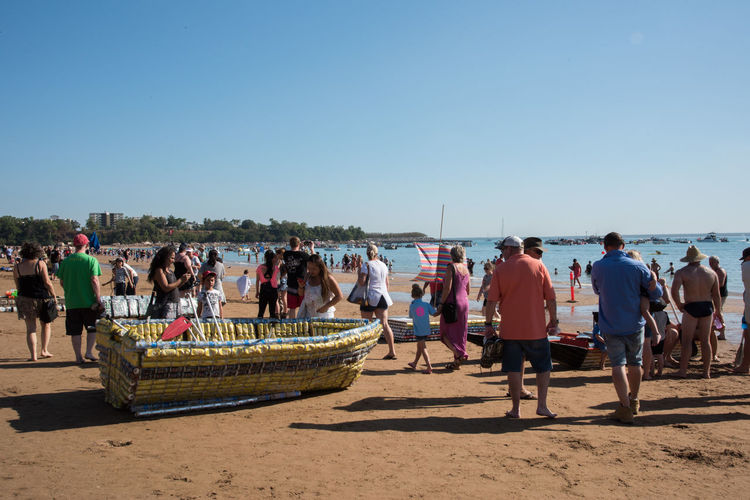Darwin, Northern Territory, Australia-July 22,2018: Crowds on the Timor Sea coast with nautical vessels during the Beer Can Regatta at Mindil Beach in the NT of Australia Darwin Nautical Vessel Beer Can Regatta Event Festival Annual Event People Tourist Tourism Travel Travel Destinations Timor Sea Sea Ocean Shore Coast Shoreline Coastline Seascape Horizon Over Water Northern Territory Australia Leisure Activity Recreational Pursuit Fun Lifestyles Party Gathering Socializing Party - Social Event Beach Mindil Beach Large Group Of People Togetherness Friends Vacations Transportation Tropical Dusk Twilight Sunset Group Of People Crowd Copy Space Clear Sky Sand Shadow Sunlight Real People Nature