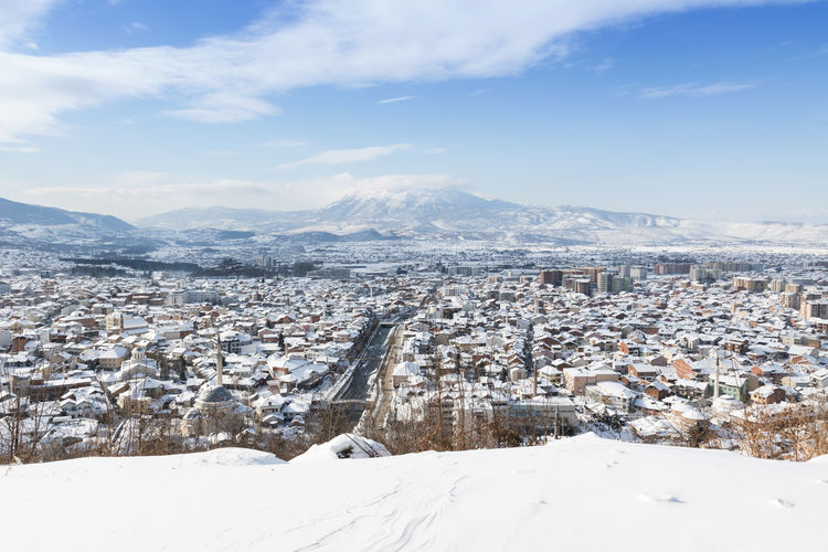panorama view of city Prizren, Kosova in the winter season Ancient Balkan Kosovo Panorama Aerial View Architecture Beauty In Nature Building Exterior Cold Temperature Historical Kosova Mosque Mountain Mountain Range Nature Prizren River Scenics Snow Tranquil Scene White Color Winter