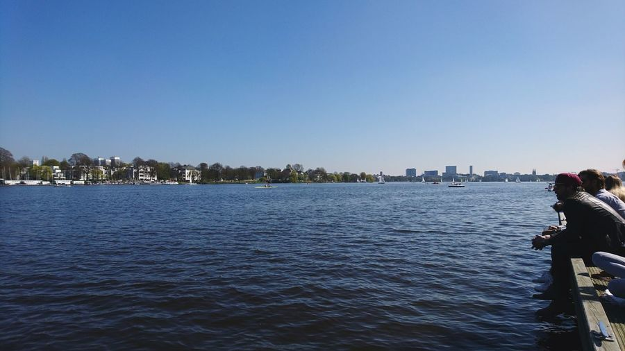 People enjoying the Außenalster. · Hamburg Germany Hh 040 Alster Alster River River Water A Lot Of Water Blue Blue Water Blue Sky No Clouds People Beautiful Day