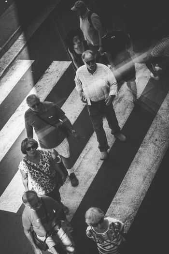 High angle view of people sitting on shadow