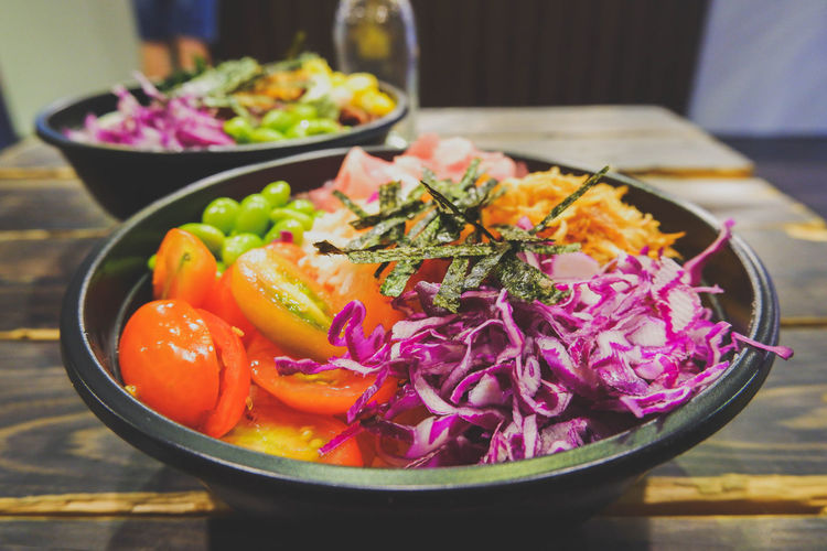 High angle view of salad in bowl on wooden table