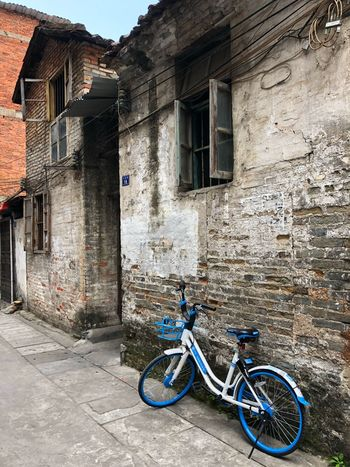 A scene of contrasts. Nostalgicmoments Tranquilidad Quiet Places No People Solitude City Street Old And Modern Old Buildings Stone Buildings Old Neighborhoods Contrasts Bicycle Architecture Building Exterior Built Structure Outdoors No People Day