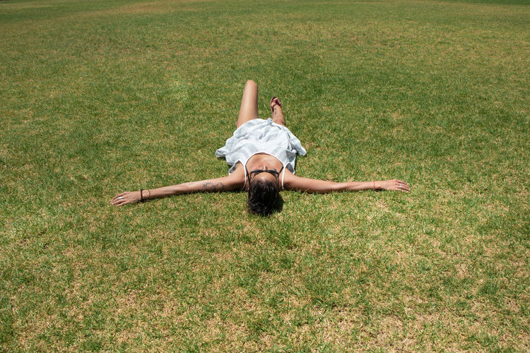 Full length of woman lying on grass