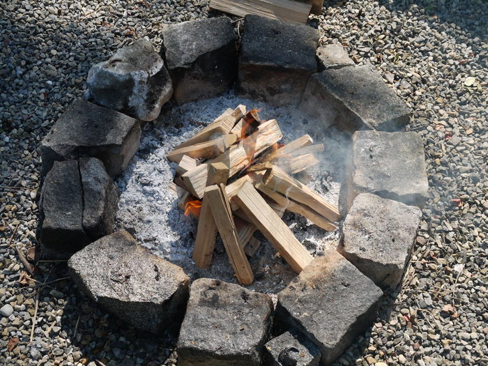High angle view of firewood stack on rock