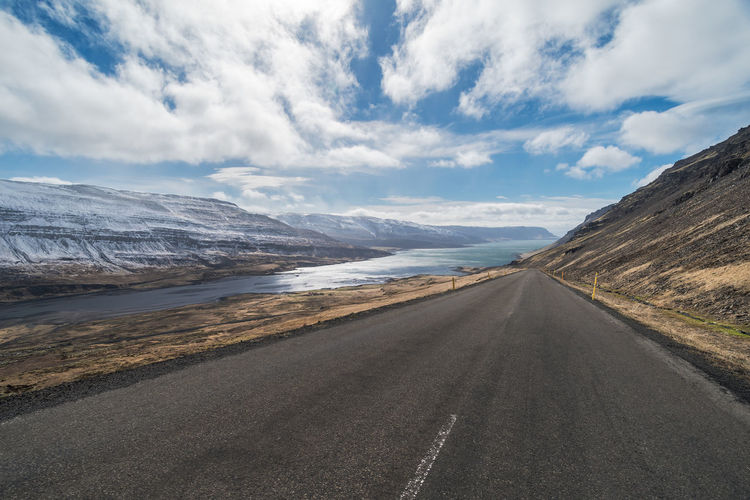 Looking down the road at dramatic scenery, isolation, Kollafjordur, Westfjords, Iceland Iceland Isolated Adventure Beauty In Nature Cloud - Sky Cold Day Exploration Explore Extreme Terrain Fjord Isolation Landscape Mountain Nature No People Outdoors Road Scenics Sky Tranquil Scene Tranquility Transportation West Fjords Westfjords