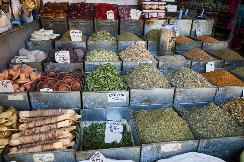 A variation of dried teas, herbs and spices outside a market stall in fez, morocco