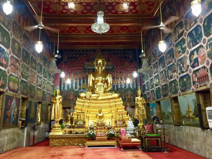 Main buddha hall Architecture Built Structure Belief Building Religion Place Of Worship Spirituality Indoors  Lighting Equipment Gold Colored No People Art And Craft Sculpture Ceiling Illuminated Gold Statue Ornate Altar