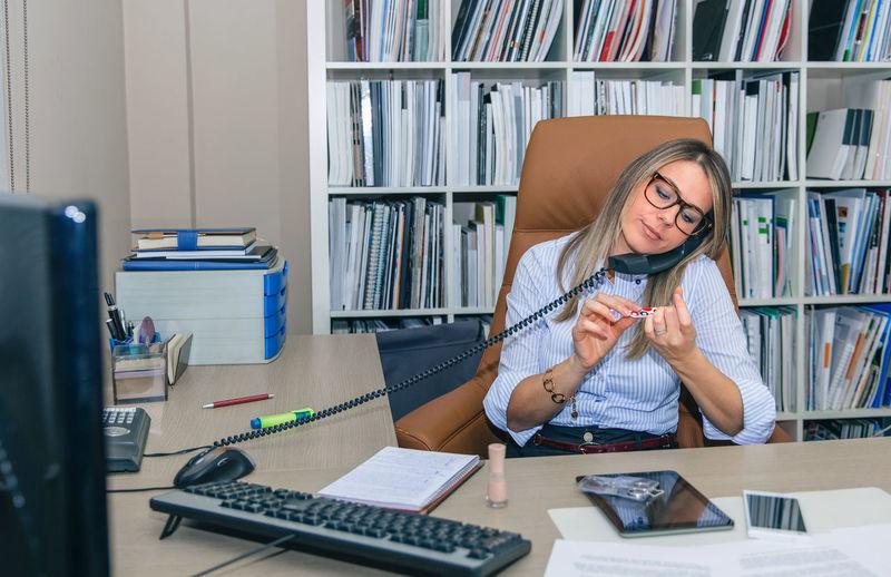 Full length of senior woman using mobile phone