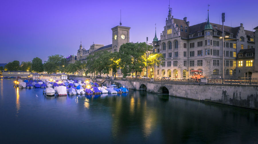 View of boats in water at night