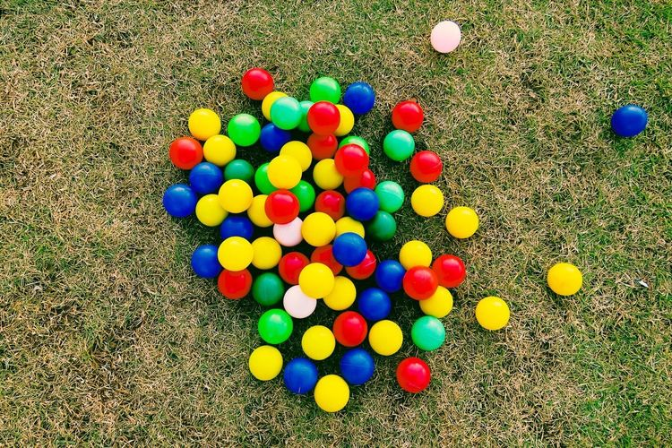 High angle view of multi colored balls on grass