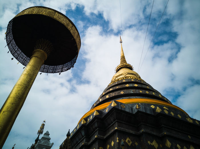 Low angle view of wat phra that lampang luang against sky