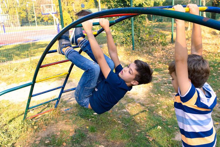 Children playing on playground at park