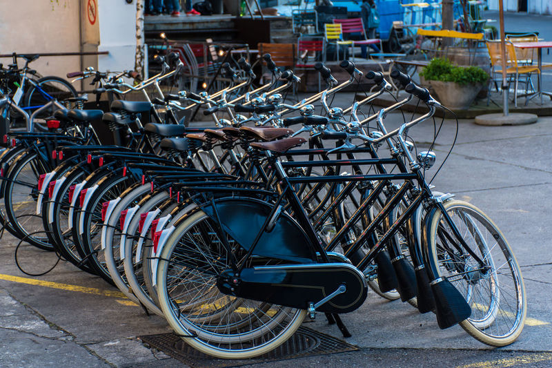 many black bicycle Bicycle Bicycle Rack Day Land Vehicle Large Group Of Objects Mode Of Transport No People Outdoors Parking Spoke Stationary Transportation Wheel