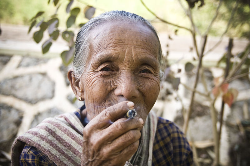 Adult Burma Check This Out Cheerful Cheroot Close-up Day Gray Hair Headshot Lifestyles Myanmar Old Woman Smoking Outdoors People Portrait Real People Senior Adult Senior Women Smiling Smoking Stogie Travel Photography Wrinkled