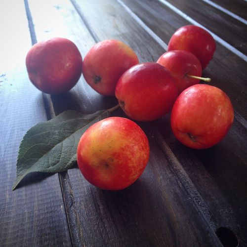 High Angle View Of Red Apples On Table