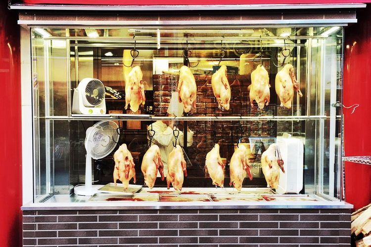 Cooked chickens displayed in cabinet