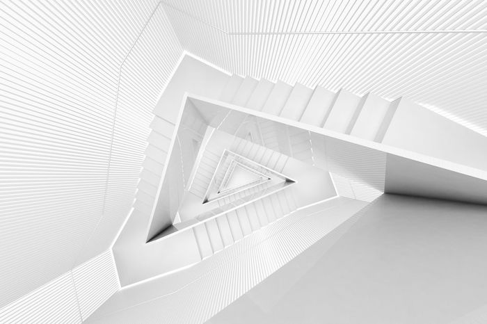 Directly above shot of white spiral staircase in building
