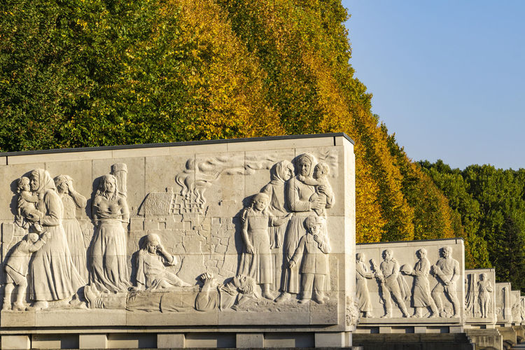 Berlin, Germany, October 11, 2018: Soviet War Memorial at Treptow Park with Sarcophagi Berlin Germany 🇩🇪 Deutschland Horizontal Color Image No People Outdoors Plant Tree Nature Day Architecture Sarcophagus Soviet War Memorial World War II Memorial Autumn Autumn colors Beauty In Nature Treptower Park White Color Bas Relief Monument Forest Group Of Objects Landscape