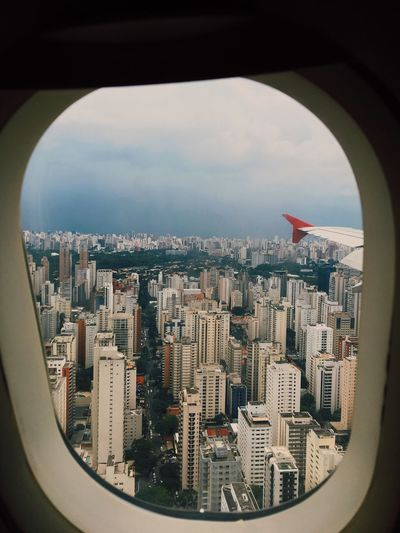 Aerial view of city seen through airplane window