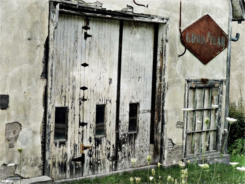 Old garage Door in Dunedin Ontario along the banks of the Noisy River Cycling tour Brucegreysimcoe