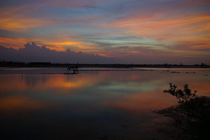 Sunset in North coast line Shot By Arif Wibowo Like Tambak Garam Photography By @jgawibowo Photography Tambak Garam Reflection Sunset Water Nature Sky Cloud - Sky Landscape Scenics Beauty In Nature Tranquility