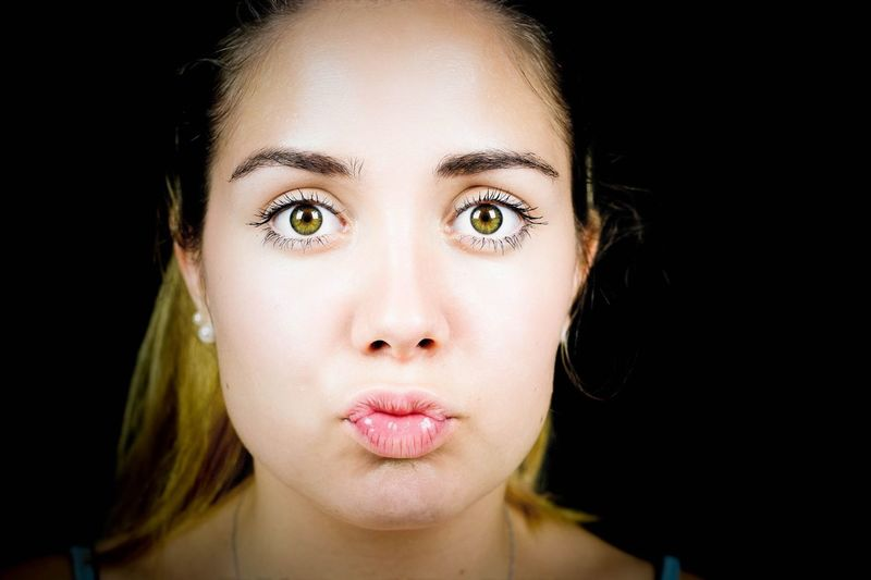 Portrait of young woman making a silly face