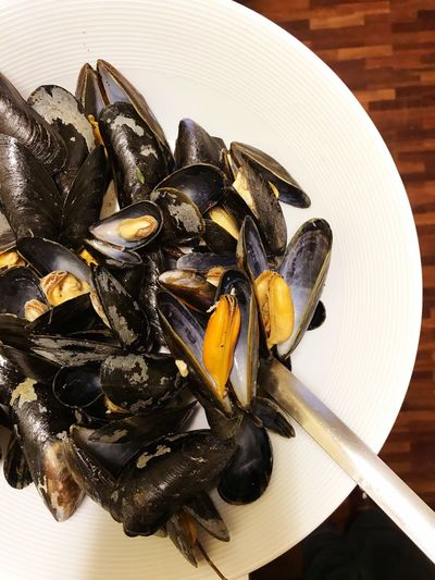 Black mussels Mussels Seafood Mussel Food And Drink Food Animal Shell Plate Healthy Eating No People Table Freshness Directly Above High Angle View Crustacean Indoors  Cooked Close-up Ready-to-eat Mediterranean Food Day