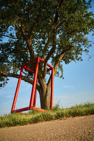 Red Frame around tree Natur Skuptur Architecture Beauty In Nature Built Structure Day Field Frame Frame In Tree Green Color Growth Land Nature Nature Sculpture No People Outdoors Plant Red Red Box Red Frame Scenics - Nature Sky Sunlight Tranquil Scene Tranquility Tree
