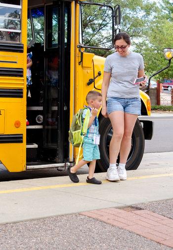 Full length of children on yellow cart