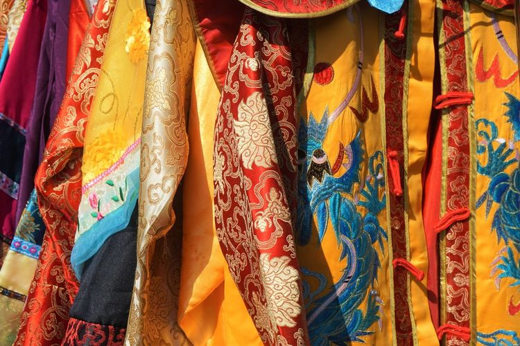 Full frame shot of multi colored scarves at market stall