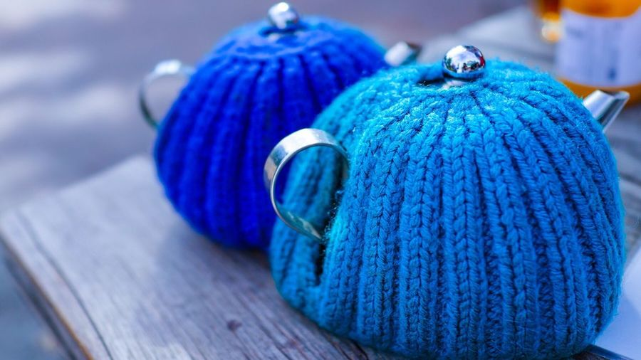Close-up of knitted cover on tea kettles