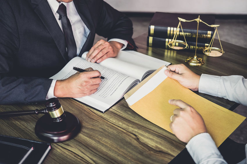 Men Publication Holding Book Human Hand Business Person People Business Indoors  Occupation Males  Businessman Office Document Connection Collaboration Counselor Fairness Barrister Gavel Balance Judgement Lawyer Verdict Inheritance