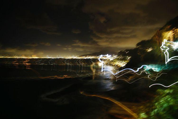 Close-up of illuminated city against sky at night