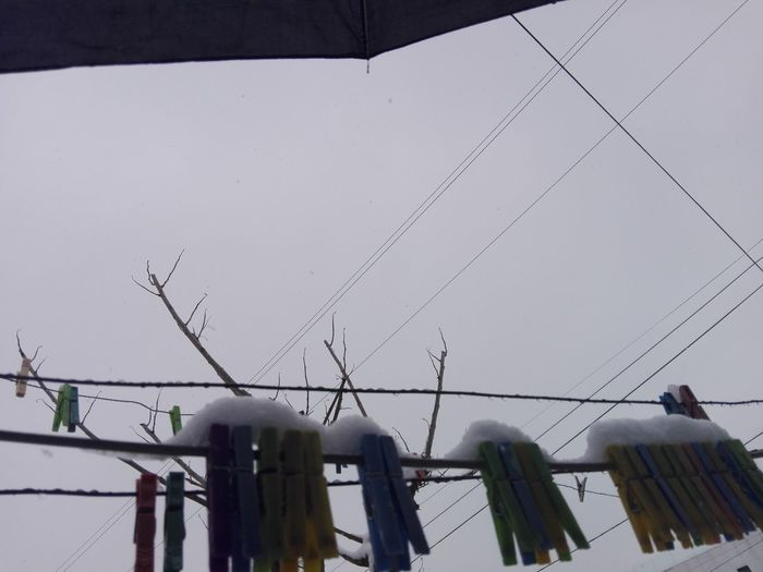 Snow On Clothespins Snowed Clothespins Snowing Snow Clothespins Clothespins Hanging On Wire Colorful Clothespins Winter Outdoors Day Hanging No People Sky