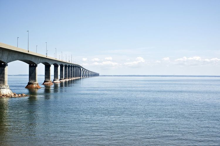 Canada: Confederation Bridge seen from New Brunswick side Confederation Bridge Daytime New Brunswick Road Architectural Column Architecture Beauty In Nature Bridge Bridge - Man Made Structure Built Structure Cloud - Sky Communication Connection Day Daylight Engineering Horizon Horizon Over Water Long Majestic Nature No People Outdoors Prince Edward Island Repetition Scenics - Nature Sea Sky Tranquil Scene Transportation Water Waterfront