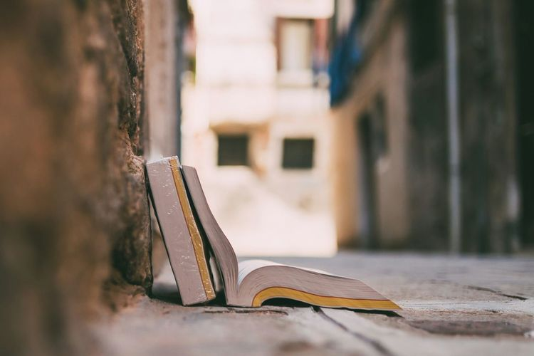 Close-up of open book on street