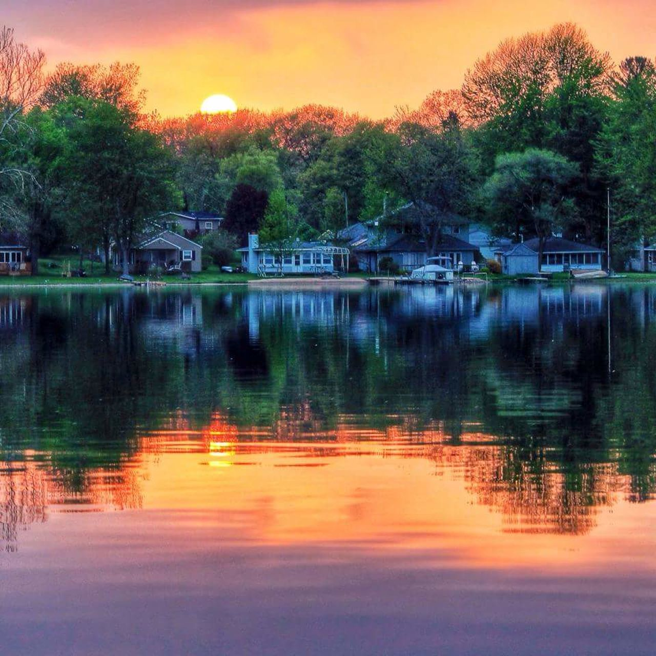reflection, tree, sunset, water, orange color, lake, tranquil scene, outdoors, tranquility, beauty in nature, scenics, no people, nature, built structure, sky, building exterior, architecture, day