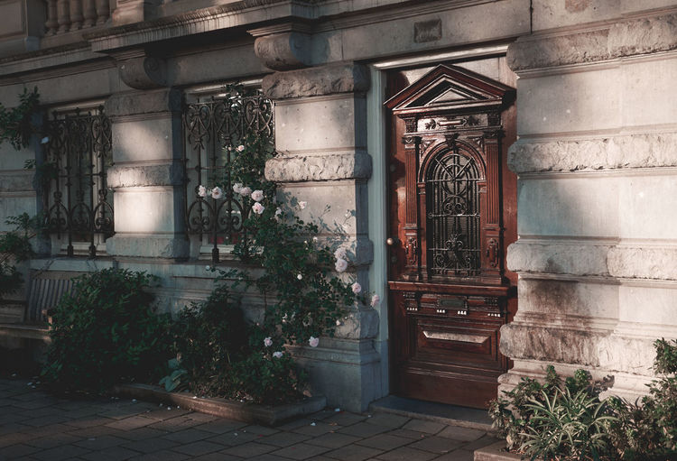 Arch Architecture Building Building Exterior Built Structure Closed Day Door Entrance Growth History House Nature No People Old Outdoors Plant Potted Plant Residential District Window