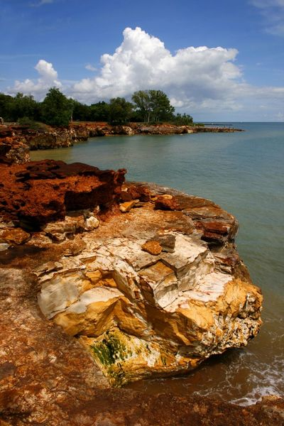 A colourful rocky coastline in Northern Territory Australia Australian Landscape Coastline Landscape Northern Territory Rocky Coastline Rocky Shore Travel Photography Beauty In Nature Cloud - Sky Day Nature No People Outdoors Rock - Object Scenics Sea Sky Tranquil Scene Tranquility Tree Water