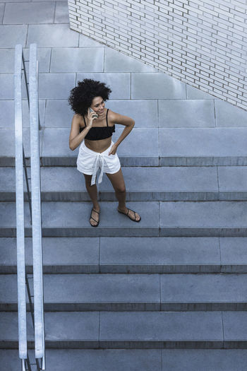High angle view of woman on staircase against wall