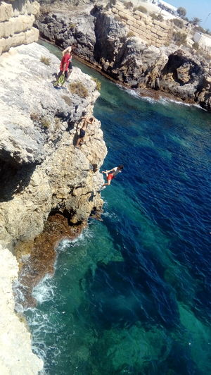 Water Sea Nature Day Beauty In Nature Rock Rock - Object Beach Real PeopleHigh Angle View Outdoors Sunlight People Turquoise Colored Mediterranean Sea Tabarca's Island Spain♥ Land Lifestyles Solid Leisure Activity Rock Formation Blue