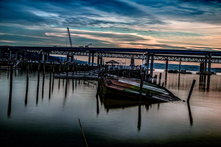 Pier at harbor against sky