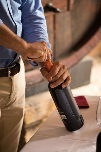 Waiting to Taste Focus On Foreground Human Hand Indoors  Travel Destinations Travel Photography Wine Bottle Wine Not Wine Tasting In Toscana Wine Vats