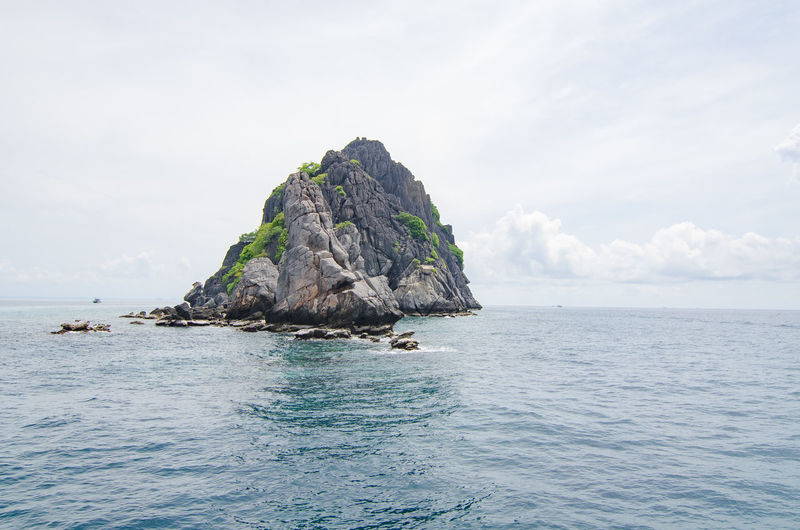 Sea Sky Water Beauty In Nature Scenics - Nature Waterfront Rock Tranquility Cloud - Sky Horizon Tranquil Scene Rock - Object Nature No People Horizon Over Water Solid Day Idyllic Rock Formation Outdoors Turquoise Colored Eroded Stack Rock
