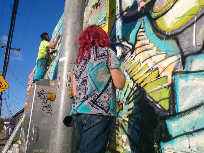my daughter watches a graffiti mural in the making Discover Your City Atxmurals Atxkids